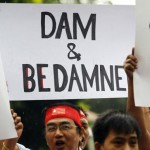 Myanmareses living in Malaysia display placards in protest against the Myitsone dam project, outside Myanmar's embassy in Kuala Lumpur September 22, 2011. Photo Credit: REUTERS/Bazuki Muhammad